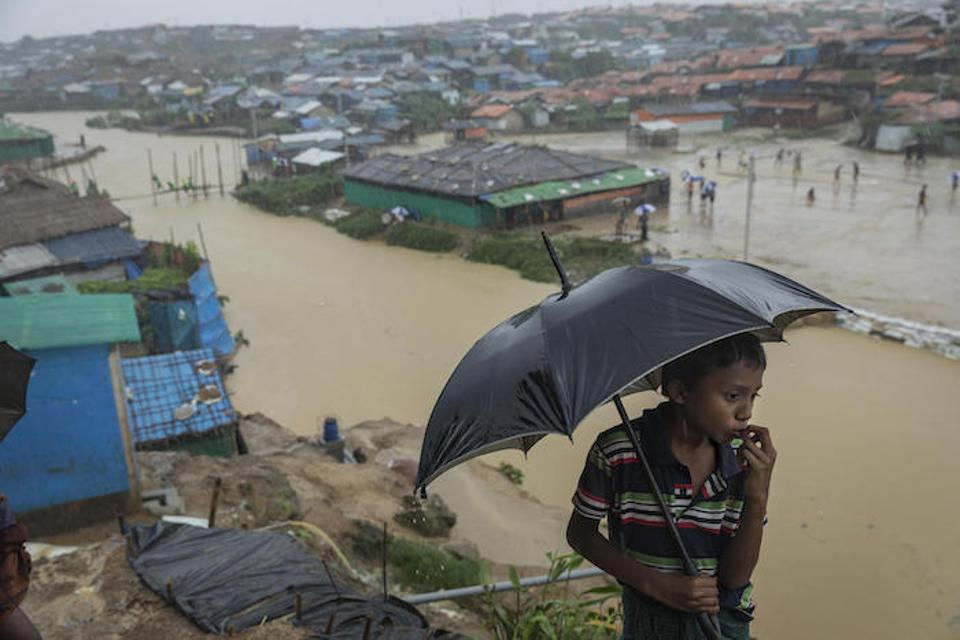 Nine-year-old Mohamed looks out over one of the canals running through Kutapalong refugee camp in Cox's Bazar, Bangladesh on July 6, 2019. Two bridges nearby were swept away by heavy monsoon rains.
