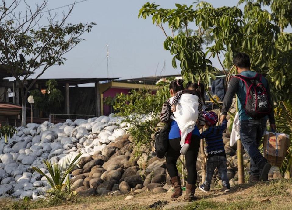 A family crosses the Suchiate River at the Mexico-Guatemala border near Ciudad Hildalgo, Mexico on January 31, 2019.