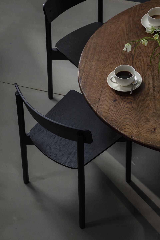 T01 Cross Chair by TAKT X PearsonLloyd; shown here in Black Lacquered Oak