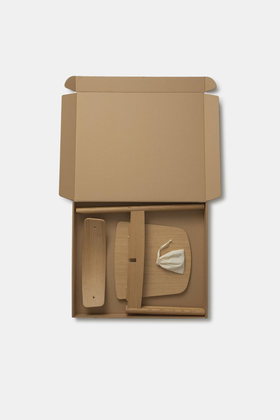 Flatpacked into a box, the Cross chair reduces delivery costs and transportation emissions.