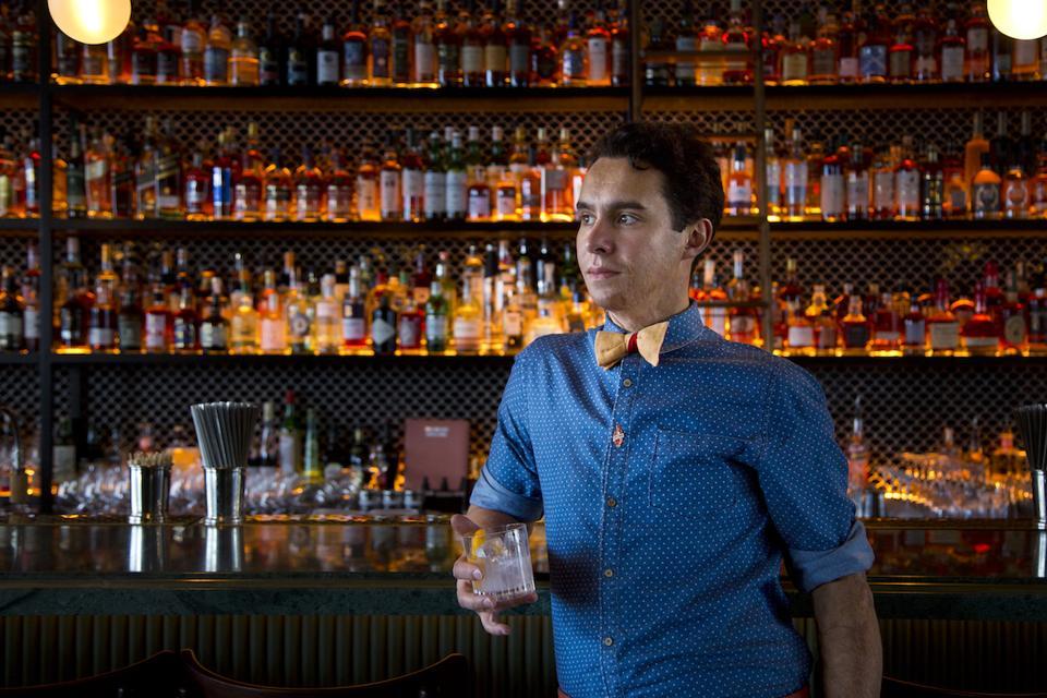 Alfred Cointreau drinking at a bar in Paris
