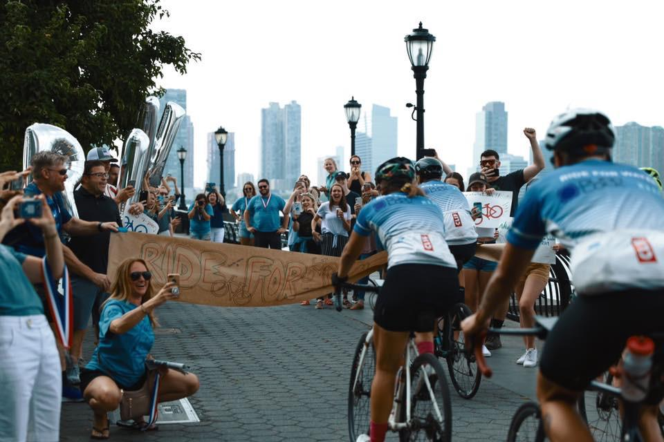 The 2019 Ride For Water team crosses the finish line in Manhattan on Wednesday, July 10.