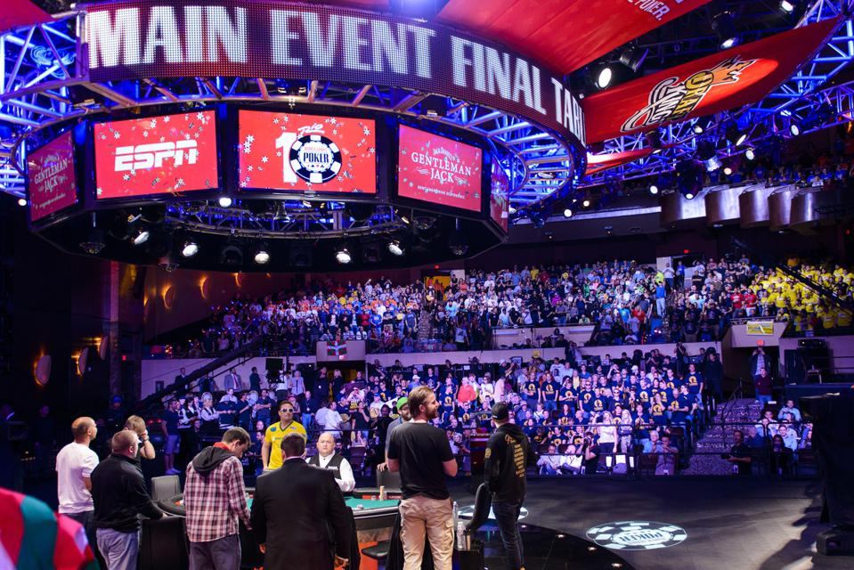 Poker players prepare to take their seats on stage for Final Table of the WSOP Main Event