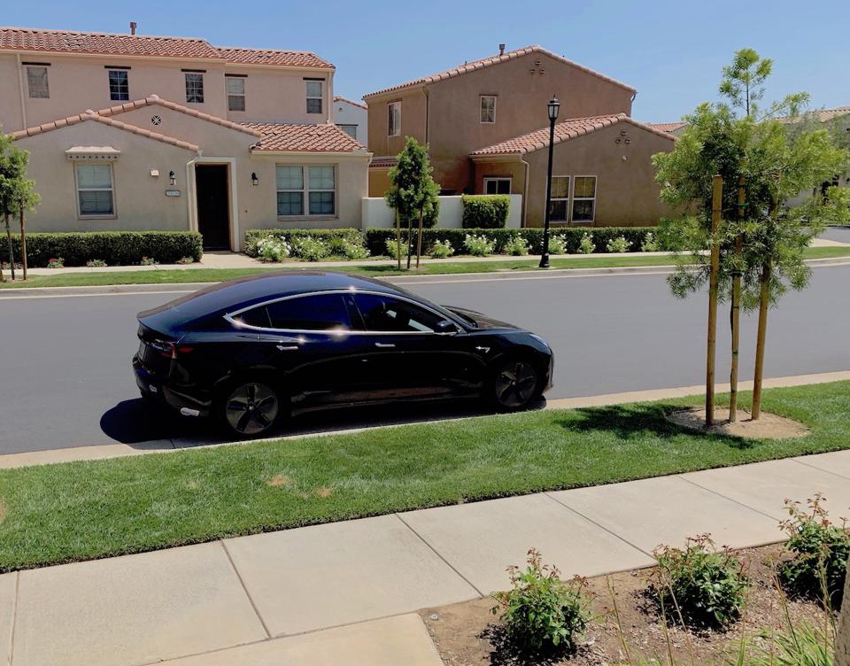 Model 3 parked outside my house. This is a family scene as the residents of my community take over Tesla's hottest car.