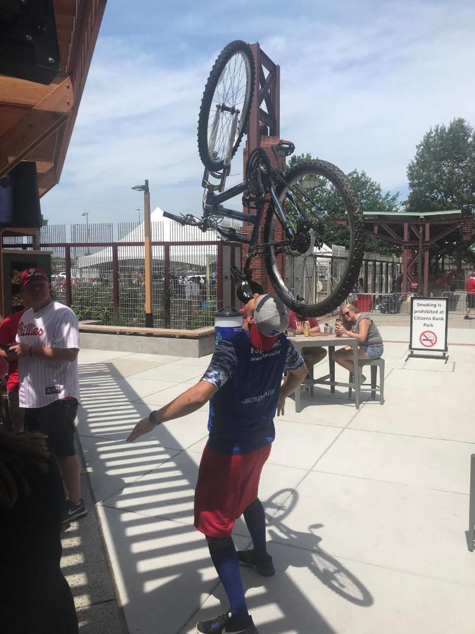 Tyler Scheuer balancing a bike on his face