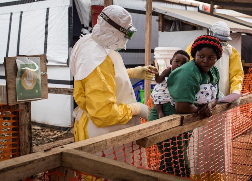 At the Ebola Treatment Center of Beni, North Kivu province, Democratic Republic of Congo on March 24, 2019, a health worker checks a child potentially infected with Ebola.