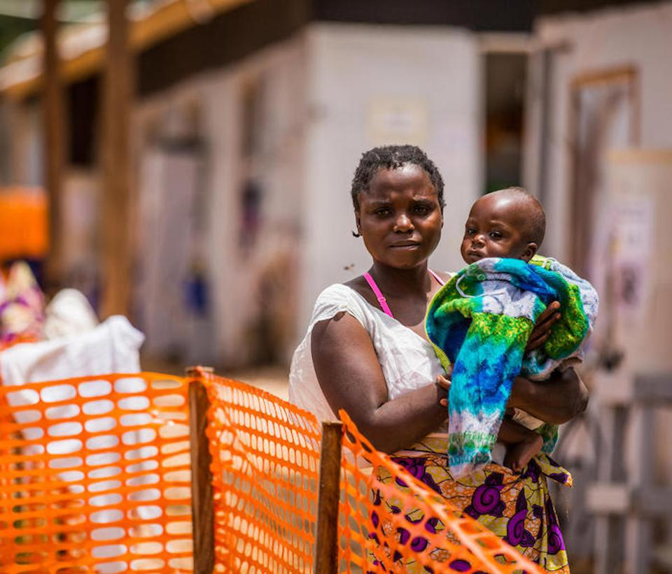 Masika Mbweki, 31, holds her son, Japhet, 10 months, by their room in the quarantine area of the Ebola Treatment Center of Butembo, Democratic Republic of Congo, 22 March 2019.