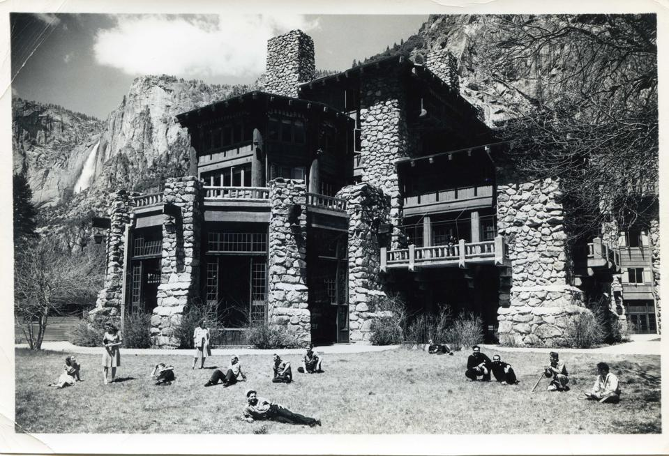 Sailors recline in front of the Ahwahnee Hotel, then the Yosemite Special Hospital