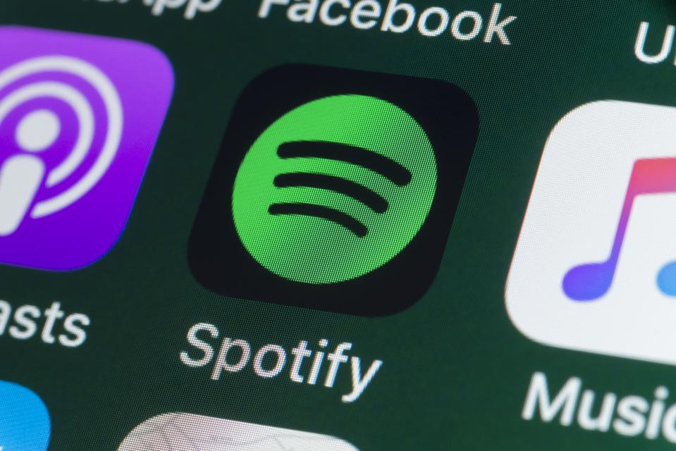 Spotify, Podcasts, Music and other Apps on iPhone screen