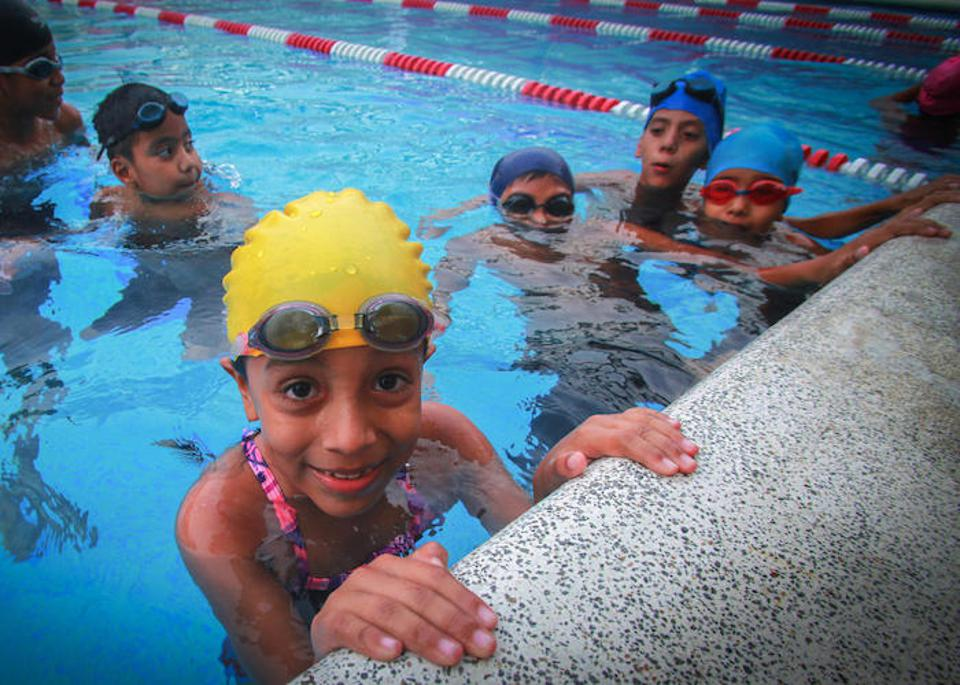 On August 9, 2017, Natividad, 7, (in yellow cap) and friends take swimming lessons at the local recreation center, part of a UNICEF-supported program to help children avoid crime-ridden streets in San Salvador, El Salvador.