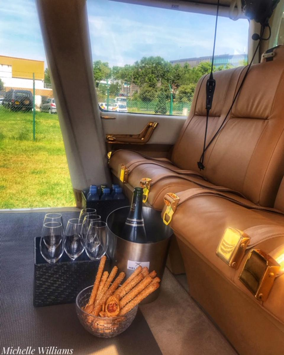 Sipping Champagne in a helicopter ride from Paris to Champagne.