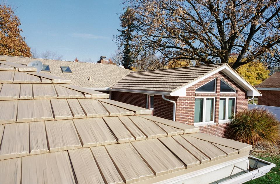 This metal tile roof has the look of a shake roof but will be far more durable and long lasting.