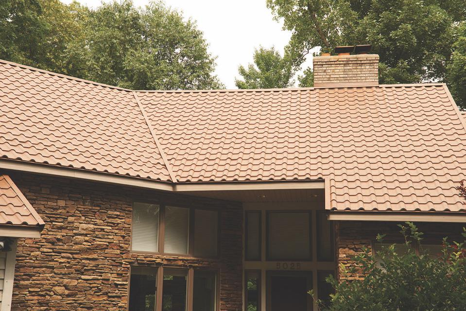 This roof looks like a tile roof but are metal tiles by CertainTeed.