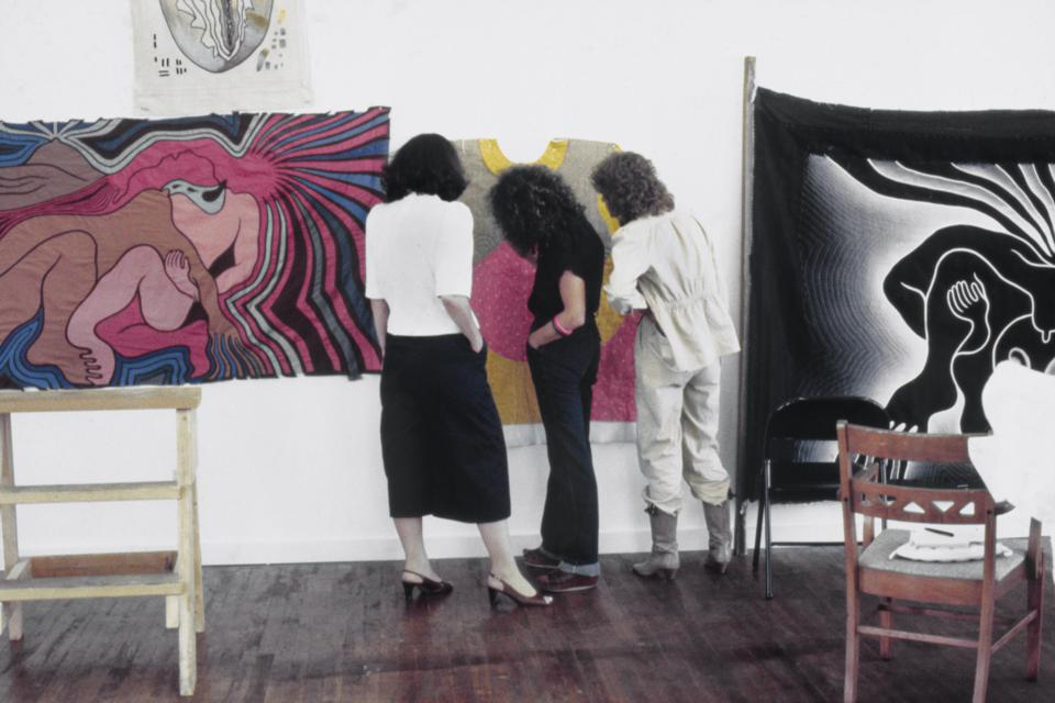 Judy Chicago reviewing Birth Project works with needleworkers in Benicia, CA 1982.