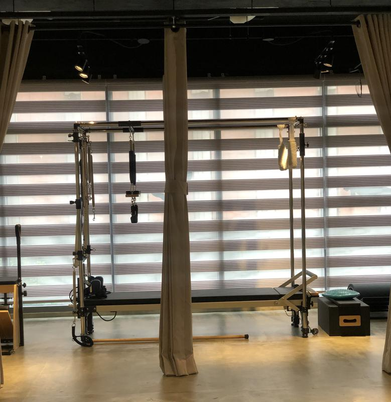 The VIP corner where clients can workout in complete privacy using the Align Pilates Cadillac