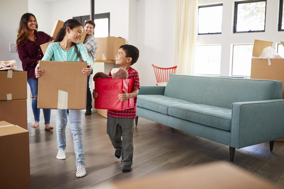 Home buyers move into their new home.