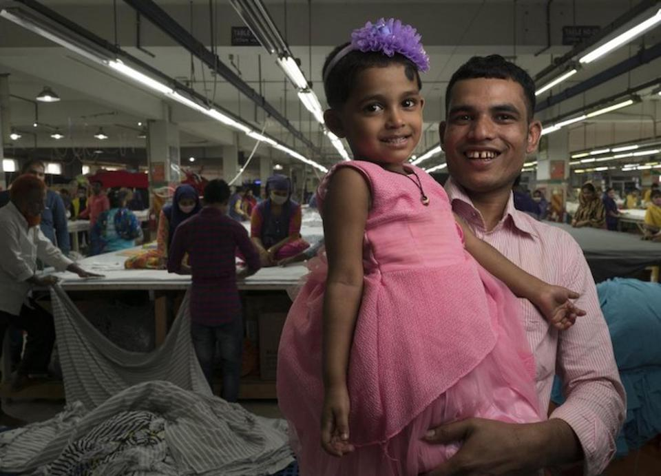 Jamal Hossain, 26, brings his 2 1/2-year-old daughter, Jui, to the UNICEF-supported day care center at the garment factory where he works in Gazipur, outside Dhaka, Bangladesh.