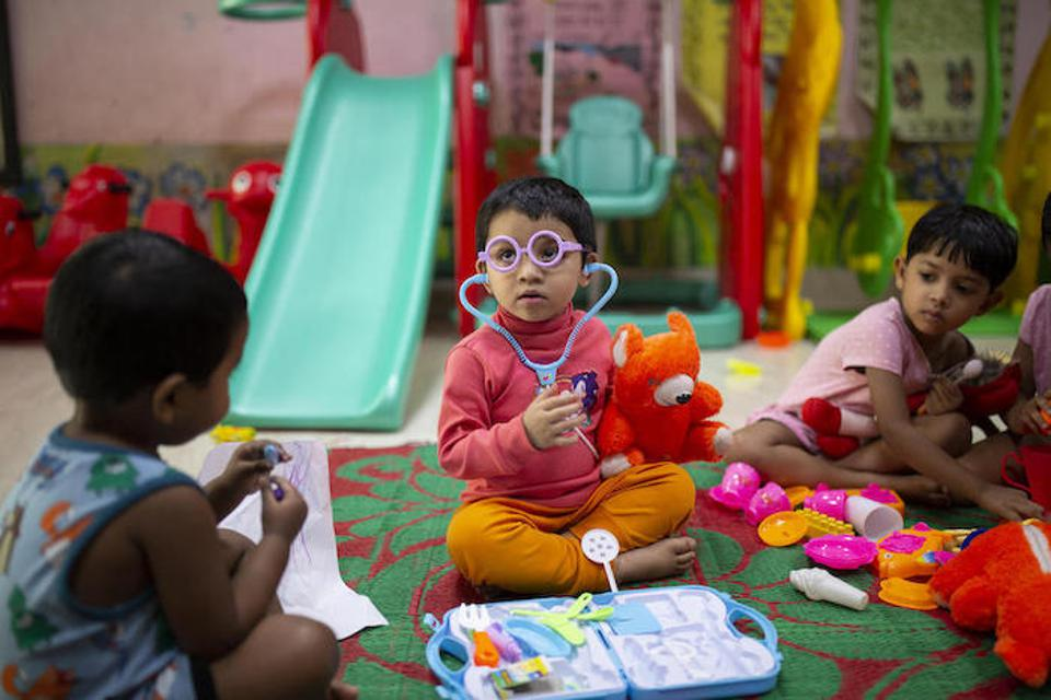 Jisha, 3, years play with a toy stethoscope and medical kit at at the UNICEF-supported Early Childhood Development (ECD) center located on the Fakir Fashion Ltd. factory where both her parents work in Narayangonj, outside Dhaka, Bangladesh.