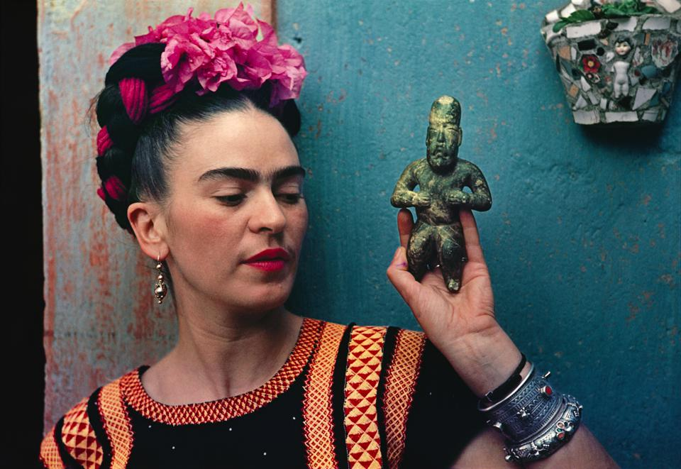 Nickolas Muray (American, 1892–1965). Frida with Olmeca Figurine. The Jacques and Natasha Gelman Collection of 20th Century Mexican Art and the Vergel Foundation.