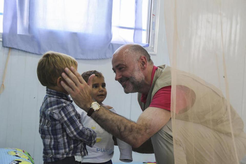 UNICEF Representative in Syria Fran Equiza visits with young children in a UNICEF Child-Friendly Space during a visit to Syria's Al-Hol camp in July 2019.