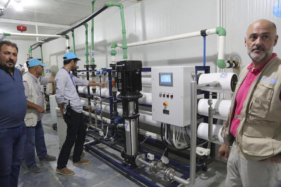 In July 2019, a UNICEF delegation visits a water purification station installed by UNICEF in Syria's Al-Hol camp.