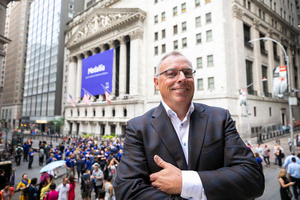 Medallia CEO Leslie Stretch poses outside the New York Stock Exchange on its IPO day.