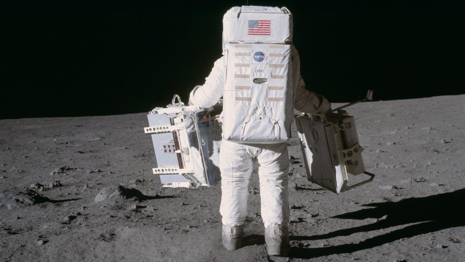 Buzz Aldrin carrying the laser retroreflector
