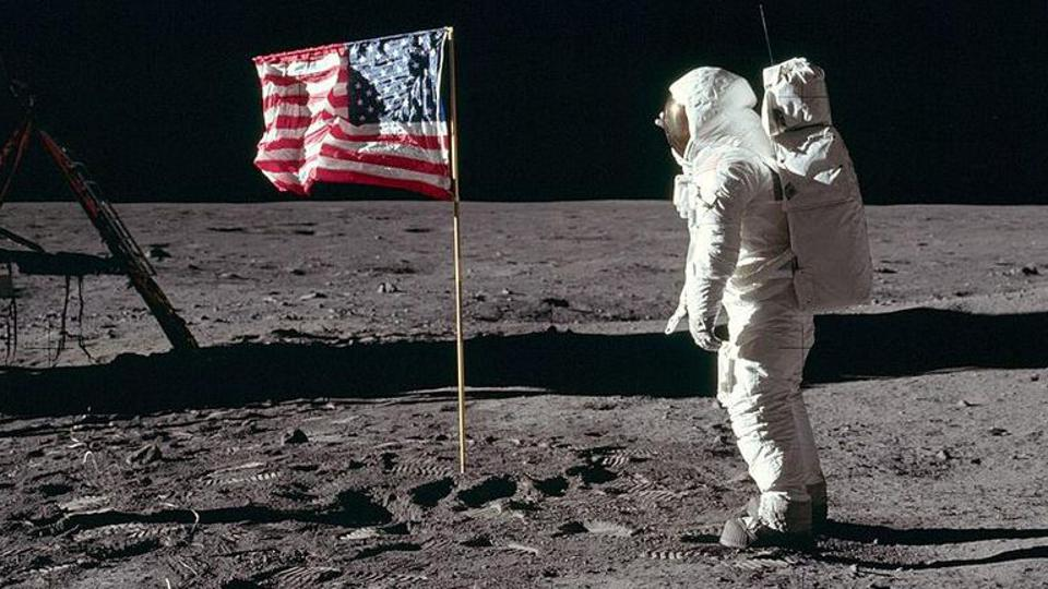 Buzz Aldrin salutes the flag