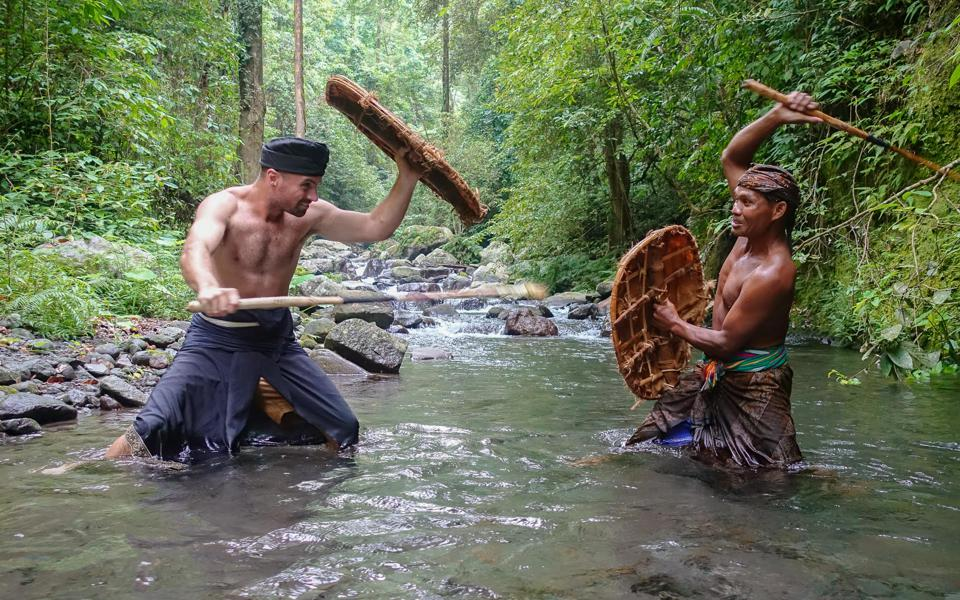 Tim in training for a stick fight with the Sasak people of Indonesia