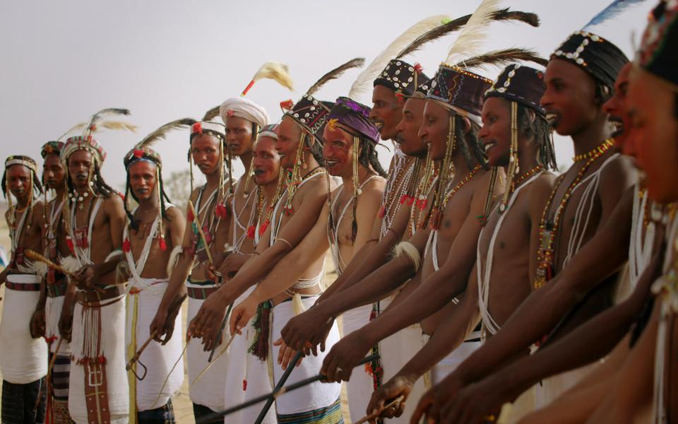 Tim performing the Gerewol dance with the Wodaabe nomads of Nigeria.