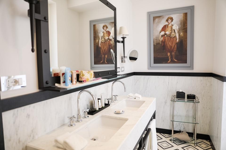 ROME, ITALY - A bathroom in a room at Hotel de la Ville
