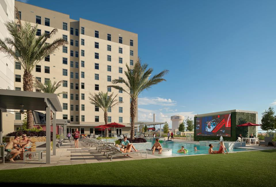 Cabanas, pool, spa and Jumbotron at Texas A&M student housing