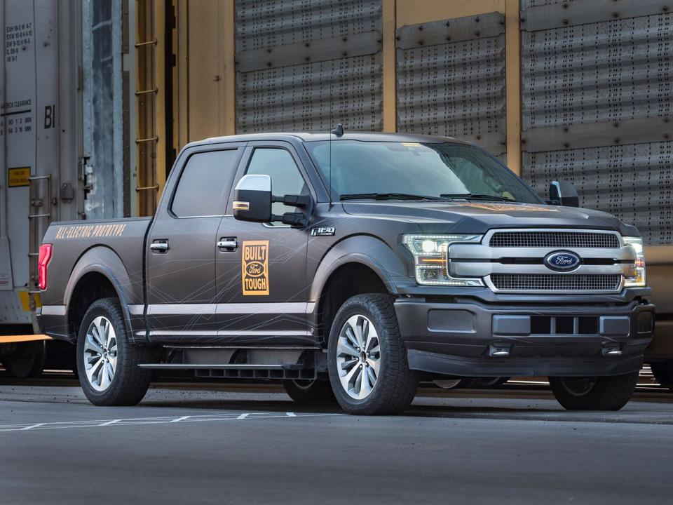 Ford F-150 Electric Truck Prototype in a rail yard.