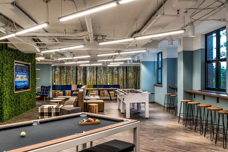 Student lounge with green wall, foosball table and billiards