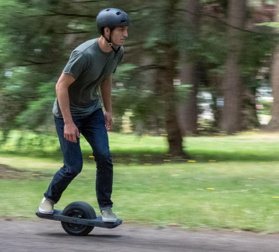 Jack Mudd of Onewheel assumes the riding position aboard the new Onewheel Pint.