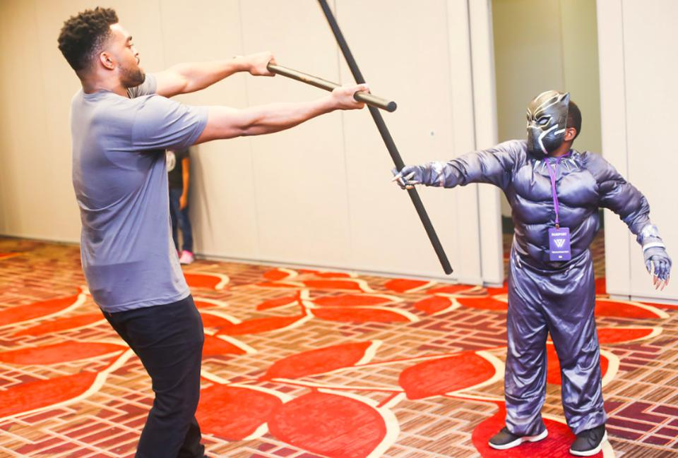 A child learns how to be a Jabari warrior at Wakandacon 2018.