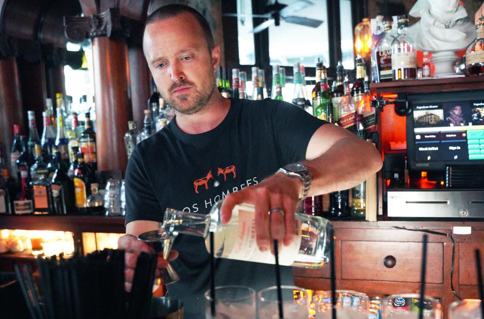 Aaron Paul makes a Dos Hombres cocktail during his launch event.