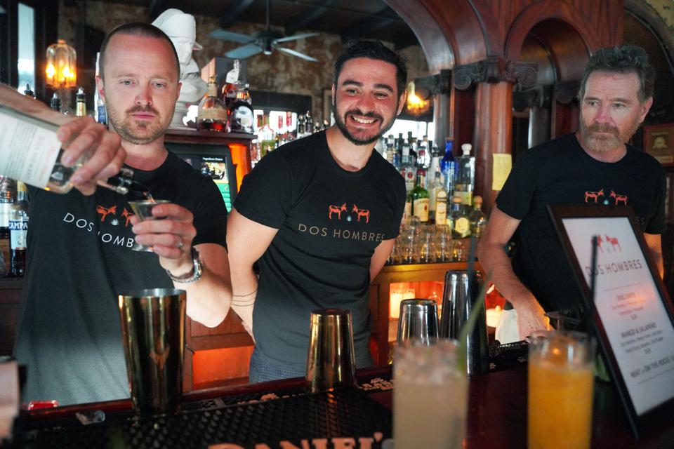 Aaron Paul, Brendan Bartley, and Bryan Cranston bartend at the Dos Hombres launch.