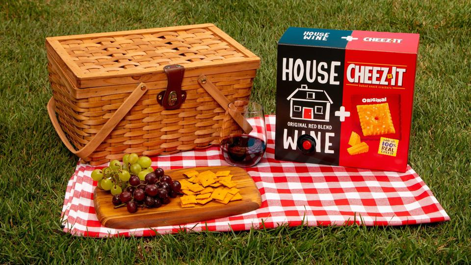 House Wine and Cheez-It combo pack on a picnic blanket.
