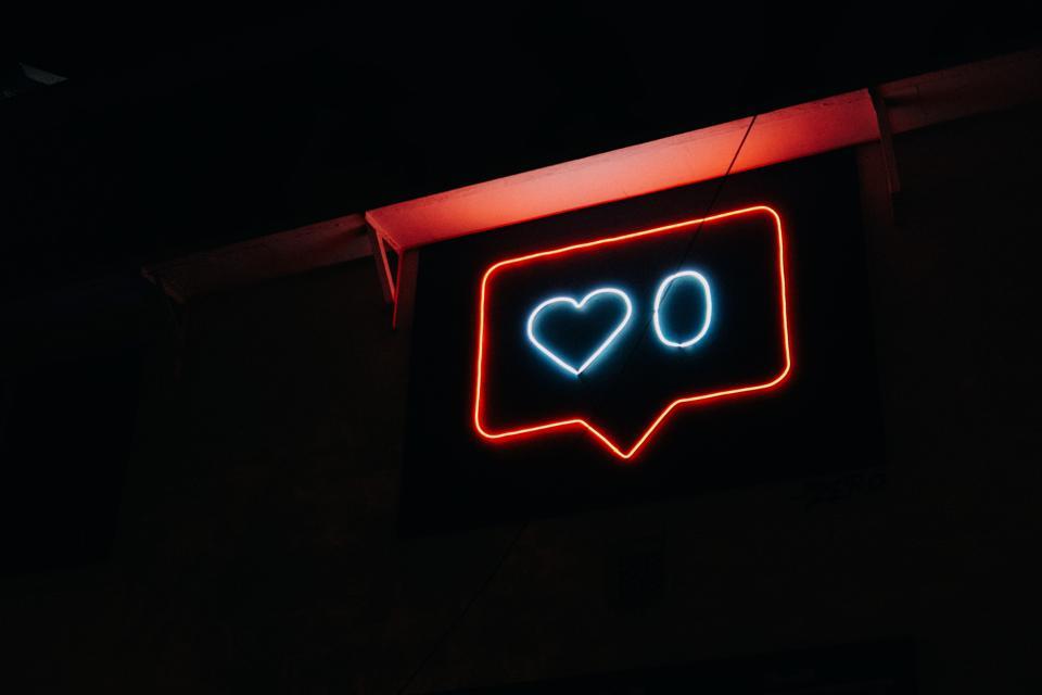 Social Media ″like″ symbol in neon