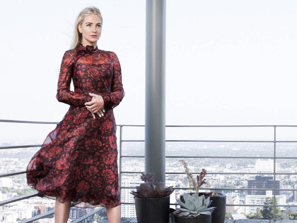 NIkki Lund stands atop a balcony in LA/