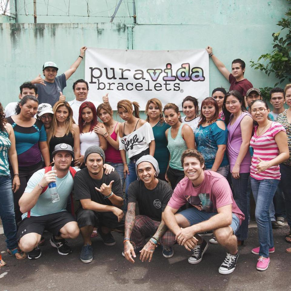 Pura Vida founders with local artisans in Costa Rica