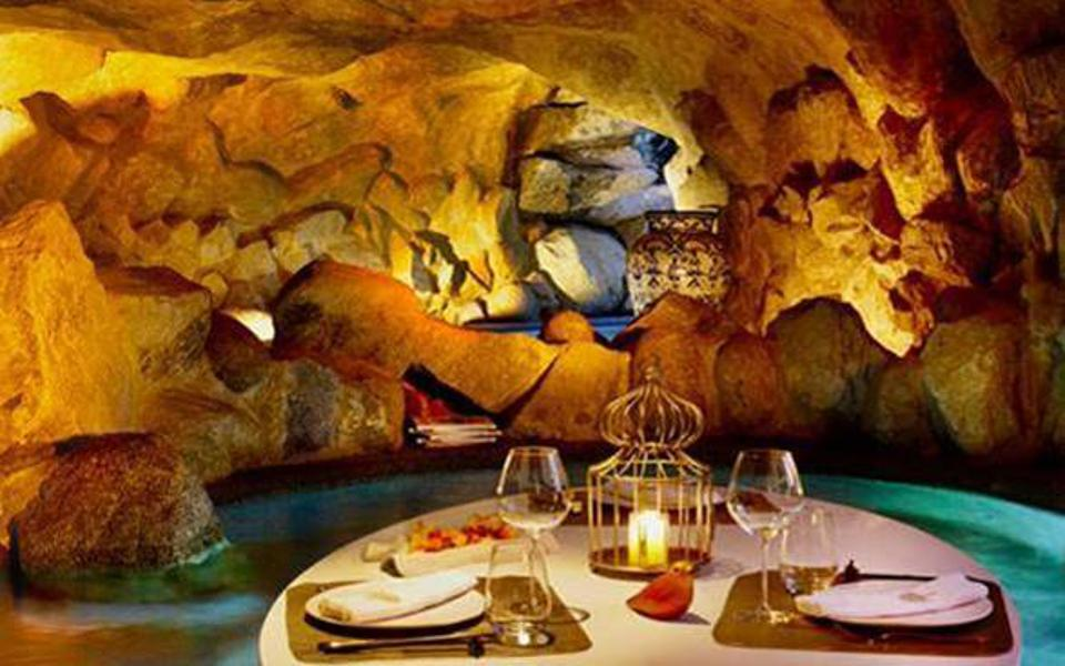 Tables set up in a grotto in Los Cabos, Mexico.