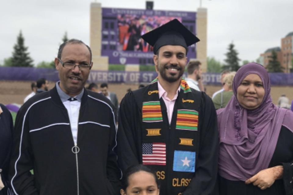 Malim with his parents at his college graduation.