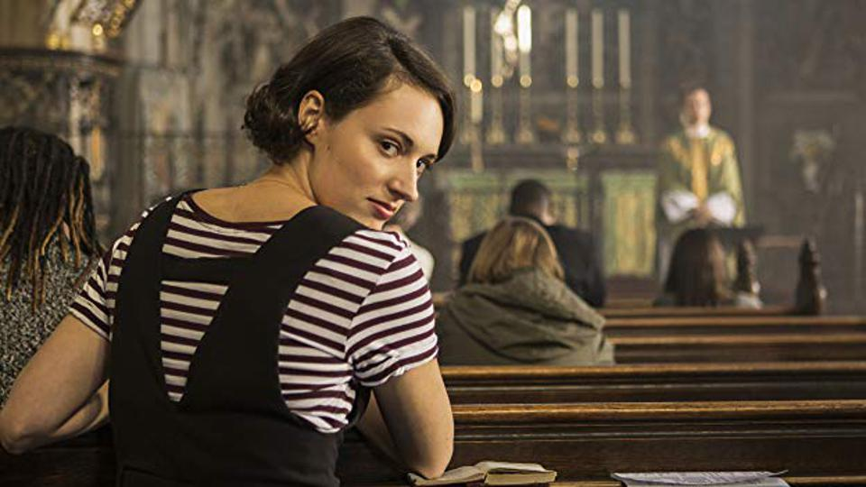 Scene from ″Fleabag″ with Phoebe Waller-Bridge in a church, The Priest in background