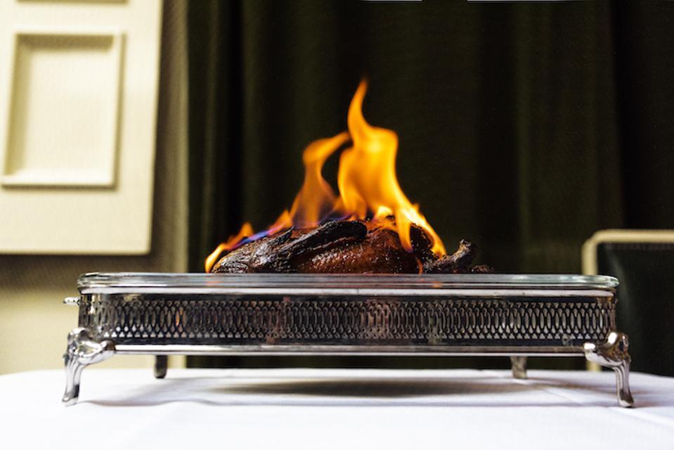 Roast Duck Flambé, roasted duck, duck flambé, angie mar, The Beatrice Inn, new york