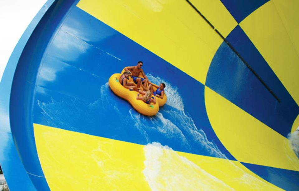 Guests get a thrill ride at Rapids Water Park.