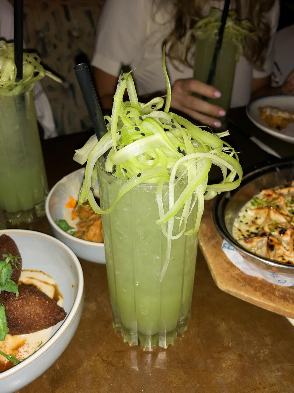 A cucumber lime cocktail at Byblos Miami and the lamb kibbeh (left)