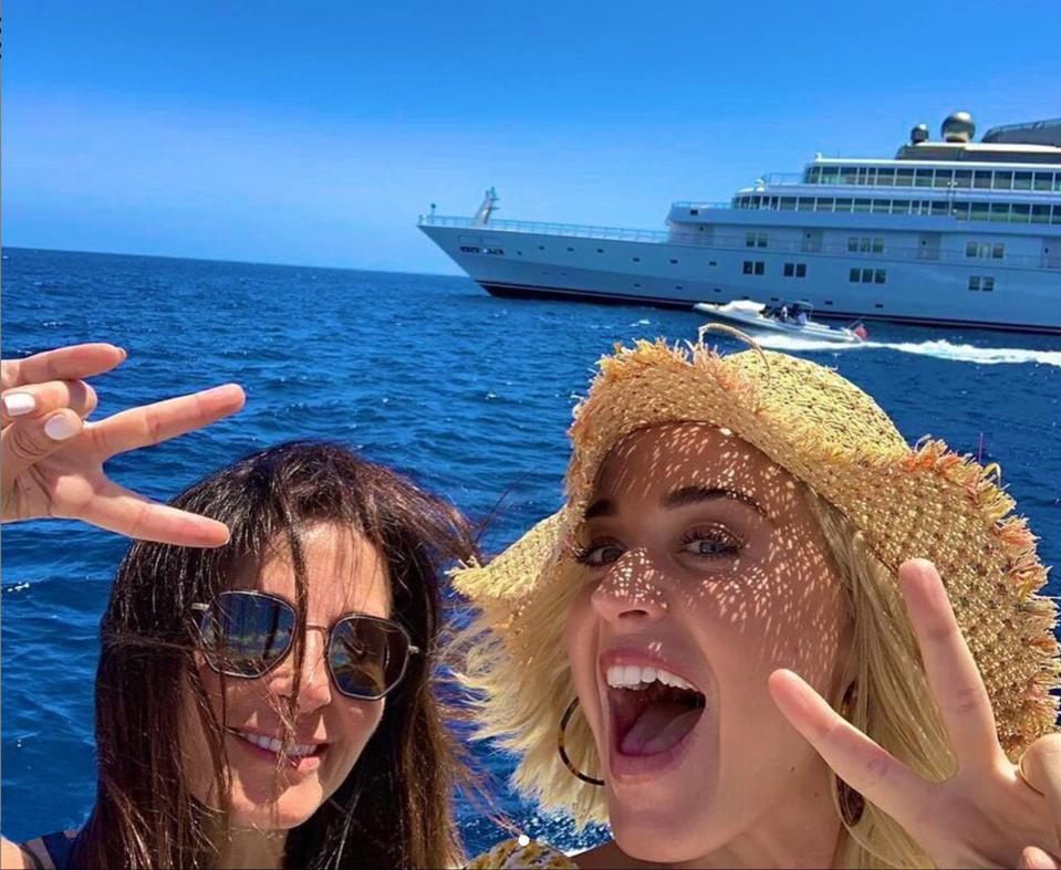 Restaurateur Janet Zuccarini and singer Katy Perry en route to David Geffen's Rising Sun yacht