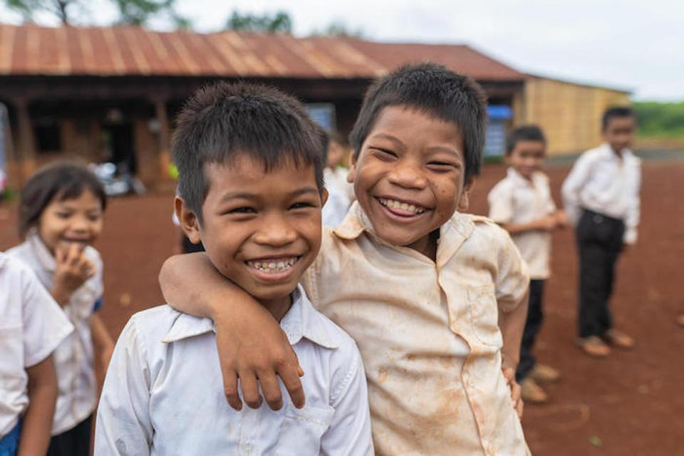 Two friends share a laugh at the UNICEF-supported Thouy Ampil Primary School in Thouy Ampil Village, Ja Oung Commune, Ratanakiri Province, Cambodia.